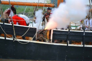 Firing the guns at the Conwy Pirate Festival